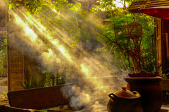 Morning sun. Shines through the smoke of an ancient outdoor kitchen Royalty Free Stock Photo