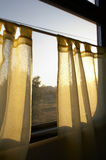 Morning sun shines in a window. The morning sun shines in a window on a curtain of a fast train Stock Photography