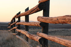 Morning sun shining on a ranch fence in Wyoming. Stock Photos