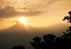 Morning sun through storm clouds Stock Photography