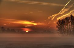 Morning sun. A sunrise on a field in the Netherlands stock photo