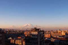 Yerevan with Mount Ararat. Morning sun in Yerevan, the capital of Armenia with the impressive Mount Ararat together with the Little Ararat Royalty Free Stock Images
