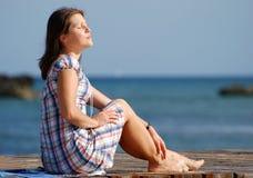 Morning Sunbath. The girl having sunbath in the morning on Sandyport beach in Nassau, The Bahamas royalty free stock photos