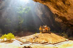 Morning sunbeam on golden buddhist pavilion in wild cave Stock Photography