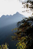 Morning Sunbeams. Morning sun on Mountains, sun shining across mountain tops above the valley Royalty Free Stock Photos