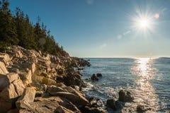 Morning Sunburst Over Rocky Maine Coast. In Acadia Royalty Free Stock Photo