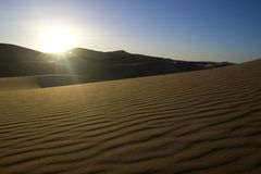 Morning sunlight in the desert. Picturesque morning sunlight in the moroccan sand dunes of Erg Chebbi Royalty Free Stock Images