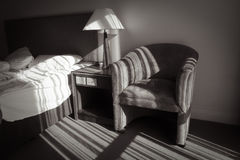 Morning sunlight streaming into hotel room. Royalty Free Stock Images