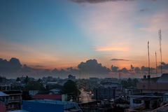 Morning sunrise with big cloud and sunbeam. Over the city in Thailand Royalty Free Stock Photo