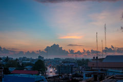 Morning sunrise with big cloud and sunbeam. Over the city in Thailand Stock Image
