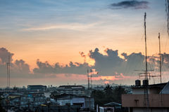 Morning sunrise with big cloud and sunbeam. Over the city in Thailand Stock Photos