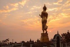 Morning sunrise Buddha statue standing at Wat Phra That Khao Noi Royalty Free Stock Photos