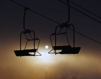 Morning sunrise with chairlifts. Stock Photo