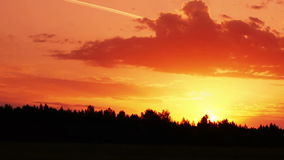 Morning sunrise through the clouds. Timelapse shot of the morning sunrise through the clouds stock footage