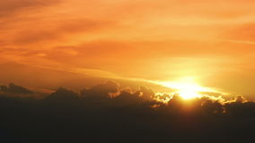 Morning sunrise through the clouds. Timelapse shot of the morning sunrise through the clouds stock video footage
