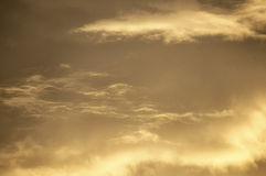 Morning Sunrise Clouds. Warm wispy clouds bathed in golden morning sunlight Stock Image