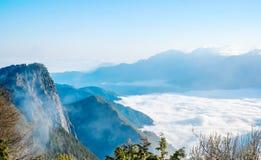 Morning sunrise, dramatic cloud of sea, giant rocks and Yushan mounatin under bright blue sky in AlishanAli mountain National Pa Royalty Free Stock Image