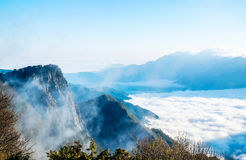 Morning sunrise, dramatic cloud of sea, giant rocks and Yushan mounatin under bright blue sky in AlishanAli mountain National Pa Royalty Free Stock Photography