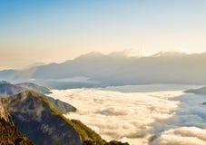 Morning sunrise, dramatic cloud of sea, giant rocks and Yushan mounatin under bright blue sky in AlishanAli mountain National Pa Royalty Free Stock Photo