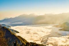 Morning sunrise, dramatic cloud of sea, giant rocks and Yushan mounatin under bright blue sky in AlishanAli mountain National Pa Stock Photography