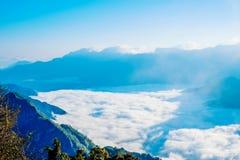 Morning sunrise, dramatic cloud of sea, giant rocks and Yushan mounatin under bright blue sky in AlishanAli mountain National Pa Royalty Free Stock Images