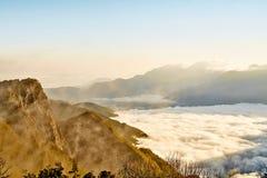 Morning sunrise, dramatic cloud of sea, giant rocks and Yushan mounatin under bright blue sky in AlishanAli mountain National Pa Stock Photo