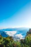 Morning sunrise, dramatic cloud of sea, giant rocks and Yushan mounatin under bright blue sky in AlishanAli mountain National Pa Stock Photos