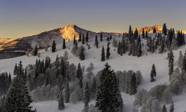 Morning sunrise in the mountains. The peak of mountains lighting by the sun, the hills with snow, a beautiful morning winter sunrise in the mountains stock images
