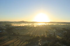 Morning sunrise over city with lot of fog Royalty Free Stock Photos