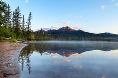 Morning Sunrise Over Edith Lake in Jasper National Park. Golden sunrise breaks out over Pyramid Mountain and low fog settles on the surface of Edith Lake in royalty free stock photo