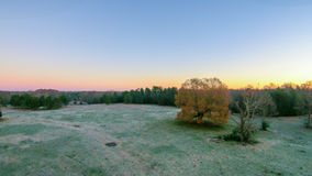 Morning sunrise over frost covered farm land Stock Image