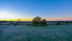 Morning sunrise over frost covered farm land Stock Photos