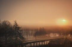 Morning sunrise over lake. And footbridge Stock Photography