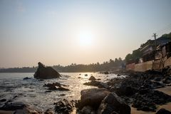 morning sunrise on the rocky sea beach royalty free stock image