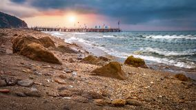 Morning sunrise in the sea with rocks on shore. Landscape of sea beach at sunrise.  stock image