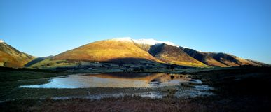 Winter at Tewet Tarn and Blencathra. Morning sunshine on the snow capped Blencathra Royalty Free Stock Image