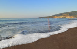 Morning surf. Foamy waves of the Mediterranean Sea washed sandy beach. Coastline Royalty Free Stock Photography