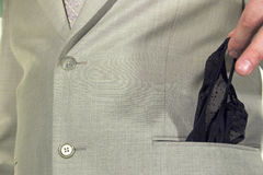 Morning surprise. A girl's pants in the suit pocket (morning surprise Stock Photography