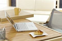 Morning table with laptop and breakfast Stock Photos