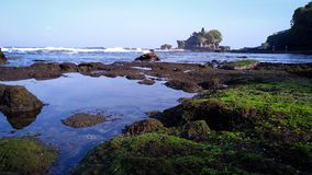 Morning at tanah lot temple with blue sky stock image