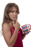 Morning Taste. Beautiful brunette with coffee cup - finger burned maybe Royalty Free Stock Image