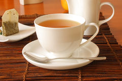 The morning tea. Spoon, cup of tea, sugar and teabag Stock Images