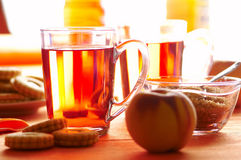 Morning tea. With some cookies and peaches Stock Image