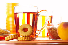 Morning tea. With some cookies and peaches Stock Photography