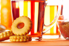 Morning tea. With some cookies and peaches Stock Photos