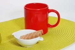 The morning tea. The closeup of colored mugs Stock Photos