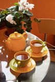 Morning tea. Tea cups and pot on table in the kitchen Royalty Free Stock Photos