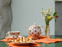 Morning tea. With sweet ring-shaped cracknel and fresh flowers Stock Photos