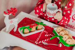 Morning tea child in red pajamas. Morning tea from a red cup of tea and a child in red pajamas Royalty Free Stock Photos