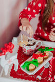 Morning tea child in red pajamas. Morning tea from a red cup of tea and a child in red pajamas Stock Photos